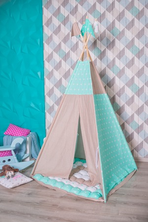 Decorative boho styled cozy hut with decor. hildrens room, Scandinavian style, minimal home interior design.Childrens Teepee tent, play tent for children, scandanavian design, colorful.