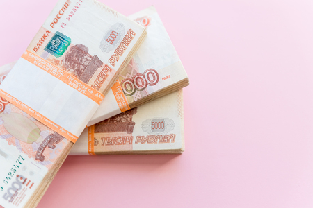 Stack of 5000 rubles packs isolated on pink. The concept of wealth, profits, business and finance. Stack money in the five thousandth bills banknotes. A lots wads of money, many cash Reklamní fotografie