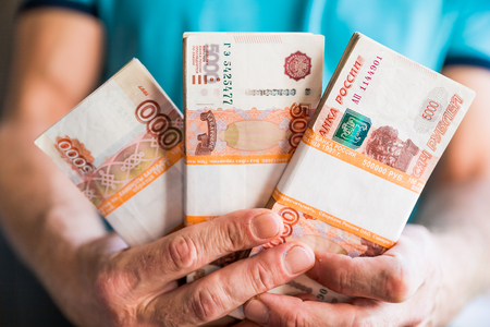 Denominations of five thousand russian rubles. Bundle of banknotes isolated in male hand.5000 rubles. five thousand cash of the Russian Federation macro Russian currency.Rich concept Stok Fotoğraf