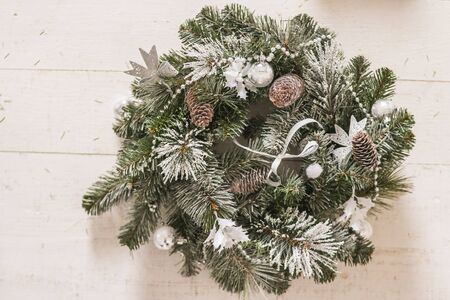 Christmas wreath on a rustic wooden background.homemade christmas wreath. Winter holidays decoration.House decorated for the winter holidays.