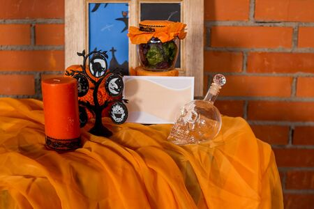 Halloween home decorations with spiders and pumpkin bucket for trick or treat. Greeting Card. Halloween pumpkin brick background. Happy Halloween picture. Ideas for Halloween. Indoor decoration.