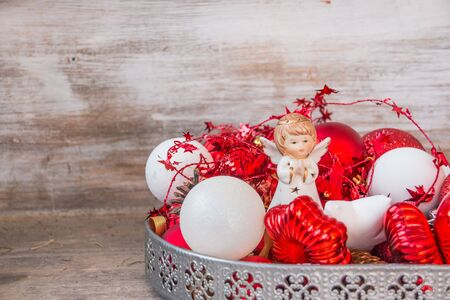 Christmas tree angel and ornaments.red and white Christmas Balls with angel with Red Beads. Home decoration for winter holidays 스톡 콘텐츠