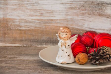 Christmas tree angel and ornaments.red and white Christmas Balls with angel with Red Beads. Home decoration for winter holidays Stockfoto
