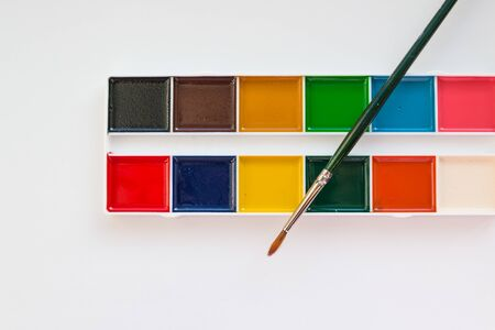 The complete set of water colour paints on a white background.Aquarelle colors in a plastic box. Different set of watercolors in palette.Copy space Stockfoto