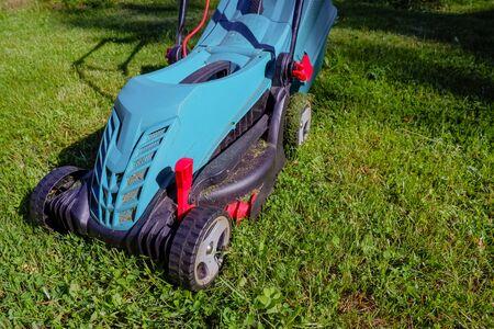 Lawn mower on green grass. mower cutting fresh grass in backyard, garden service.equipment, mowing, gardener, care, work, tool.Copy space