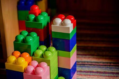 building kit. details of a different form from plastic color childrens designer for construction. constructor elements for kids. Plastic high quality constructor for children.Early learning Banco de Imagens - 128907081