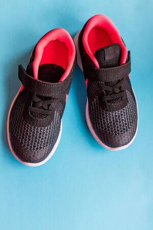 black shoes for foot and adventure travel or keep walking journey isolated on pink included clipping path.black Sport shoes for running.