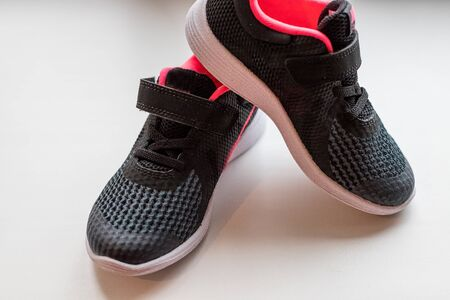 Pair of pink sport shoes on white background 写真素材