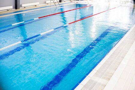Indoor swimming pool, healthy concept.swiming pool for competition.pool with swim lanes. sport and enjoyment. Relaxation,recreation and sports training 写真素材