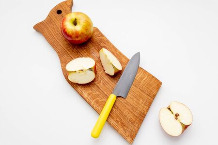 Group of apple fruit,knife,half of apples, close up fresh fruit on wooden cutting board.fruits are rich with minerals and vitamin. Fruits are good for health and help digestive system.