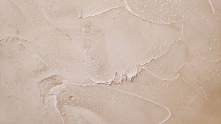 Vintage or grungy white background of natural cement or stone old texture as a retro pattern layout. conceptual or metaphor wall banner, grunge, material, aged, rust or construction.Background of a beige stucco coated and painted exterior.