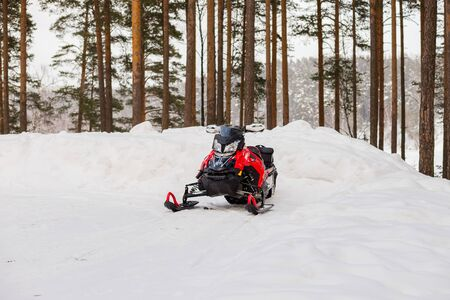 Helsinki, FINLAND - FEBRUARY 8,2019: snowmobile in forest in winter.Extreme Sport Activity and Recreation in Cold Season. Drive a Snow Mobile Vehicle If you like Speed, Ice and Fun.Winter seasonal landscape.