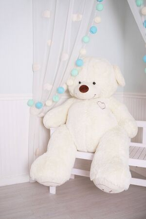 Present gift concept. Birthday decoration.handmade decor for childs party. big teddy bear.Whie soft bear. Brown toy bear sitting on bench .Present gift concept. children room. Copy space