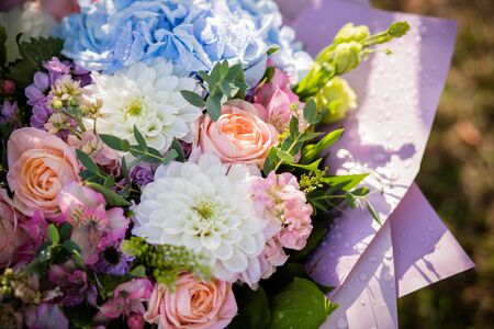 Beautiful bouquet of bride wedding flowers blue hydrangea, fresh pink roses and alstroemeria, bridal decoration. Fresh flowers in summer day. Marriage day. stylish beautiful bouquet for birthday.