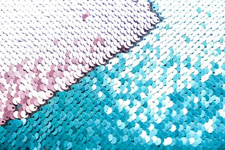 metallic sparkling sequins scales background, round sequins in fashion dress.Sequins close-up macro. Abstract background with blue sequins and lilac color on the fabric. Texture scales of round sequins with color transition. Standard-Bild
