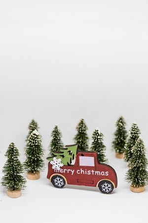 Christmas tree and blue car with lights snow winter background. Christmas holiday celebration concept.