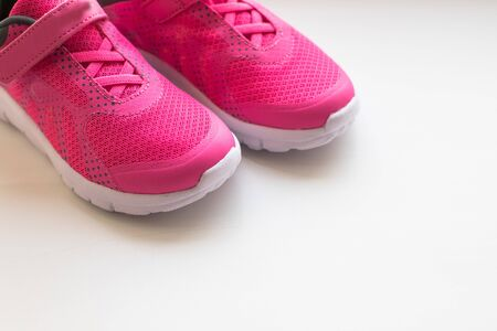 modern pinky sport shoes .Pair of sport shoes on colorful background. New sneakers on soft green background, copy space. running shoes.Pink sneakers.Pair of pink training shoes for girls.ladies womens sport fashion sneaker