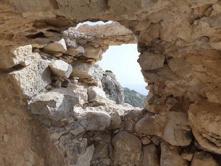 View from ruins of a church in Monolithos castle, Rhodes island, Greece.Rhodes Dodecanese Greece, Europe travel.Amazing view point. Travelling concept. Trip to Europe Фото со стока