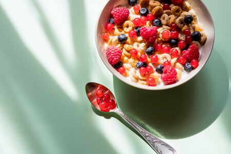 deliscious healthy breakfast with flakes and fruits isolated on white background