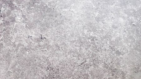 cracked stone wall background.Monohrome dark grunge gray abstract background.