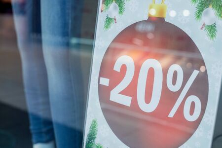 sales promotion of fashion retail store in shopping mall. store front display for fashion background.Season sale, black friday and shopping concept. Red stand SALE percent discount price in shop.Discount sign