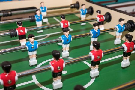 Vintage Foosball, Blue and Red Players Team in Table Soccer or Football Kicker Game, Selective Focus Stock Photo