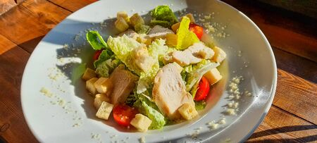 Caesar salad with roasted chicken meat