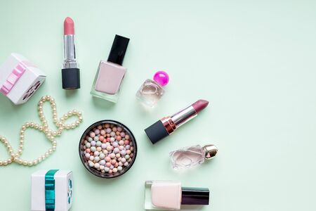 Accessories for womens beauty. Make up brush, nail polish, perfume bottle, all on pastel background,copy space. Minimalist cosmetics background.womans jewellery.Professional female makeup accessories Фото со стока - 143049374