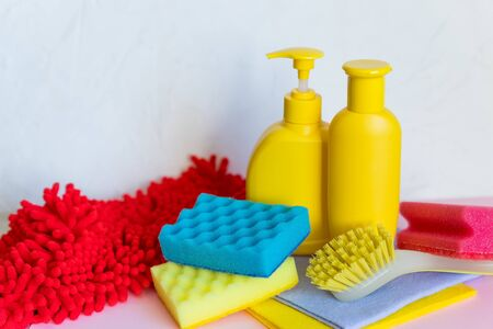 Household chemicals on white background. Professional cleaning products, spring cleaning.