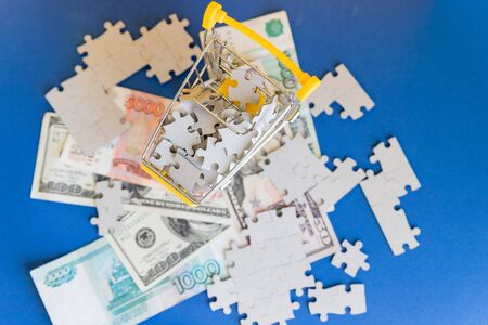 Missing jigsaw puzzle pieces on money dollar ob blue background, Business solution concept ,key for success.Conceptual of never ending conflicts between US and Russia on trade.economic crisis