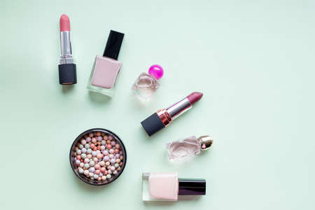 woman makeup beauty products from above on pastel background. Trendy flat lay fashion and beauty retail products, copy space.care of nails and cuticle, lips.Nail art concept. Fine art cosmetics
