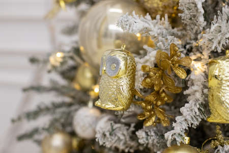 Decorated Christmas tree with golden patchwork ornament artificial gold and white balls and big gift presents for new year isolated on white background.fir branches with christmas ornaments.