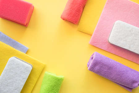 Colorful microfiber cloth, kitchen towels, sponges.Colorful cleaning set for different surfaces in kitchen, bathroom and other rooms. Cleaning service concept. Early spring regular clean up. Top view.