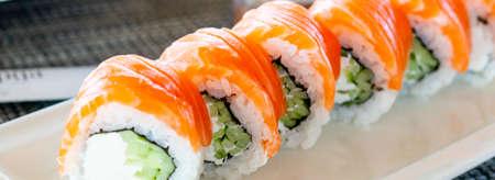 Philadelphia roll sushi with salmon, prawn, avocado, cream cheese. Sushi menu. Japanese food.Traditional japanese food roll.California rolls with shrimp. Web banner.Selective focus