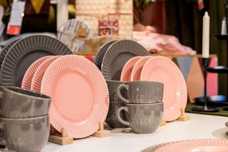 New gray, pink table setting . modern style. Serving for store catalog. Hot drinks tea or coffee. Stylish elegant ceramic dishware on shop shelves,Various kitchen utensils.Tender, pastel color