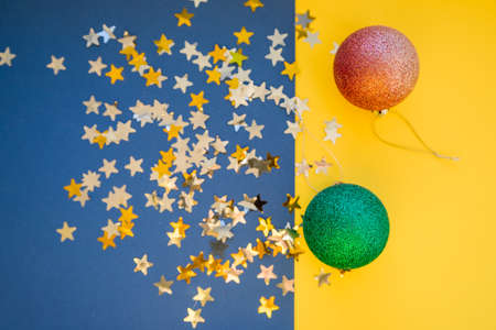 Christmas and New Year holiday background with decorations and stars confetti. shiny balls. Flat lay, top view.Christmas composition.