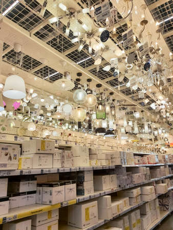 Omsk, Russia,December 9, 2020: Heap Of Different Modern Lamps And Lighting In Store .Modern lamp with lights in the furniture shop.different fashionable stylish lamp with lights in the designer center
