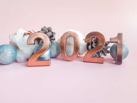 Happy new year 2021 , number on pink background and copy space - celebration concept.Abstract Card With Colors Trend - Happy New Years 2021 - Metal Number With christmas ornaments