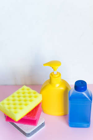 detergent bottles and chemical cleaning supplies isolated on white background.Home cleaning products. Spring cleaning, the prevention of viral diseases. Cleaning in the house, in the apartment. Banco de Imagens