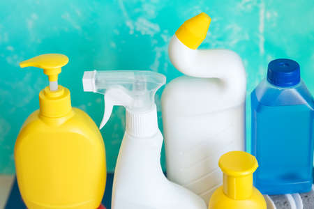 detergent bottles and chemical cleaning supplies isolated on blue background.Home cleaning products. Spring cleaning, the prevention of viral diseases. Cleaning in the house, in the apartment. Banco de Imagens
