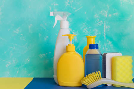 Colorful cleaning set for different surfaces in kitchen, bathroom and other rooms. Empty place for text or logo on pink background. Cleaning service concept. Early spring regular clean up. Top view. Banco de Imagens