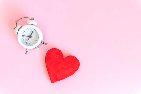Time for love - Alarm clock and hearts on pink background.Love heart with time clock. time to stay at home concept.Healthy checking plan concept.