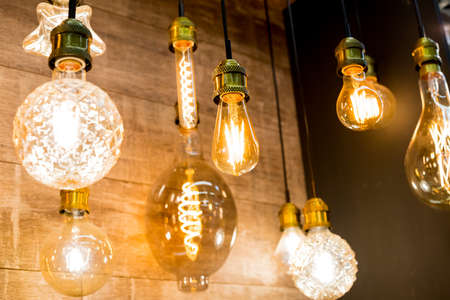Beautiful retro luxury light lamp decor glowing.House interior of loft and rustic style. vintage light bulb hanging decor glowing in dark. Blend of history and modern.incandescent Edison type bulbs