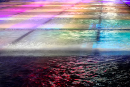 light show: Colorful details of the water in a fountain.