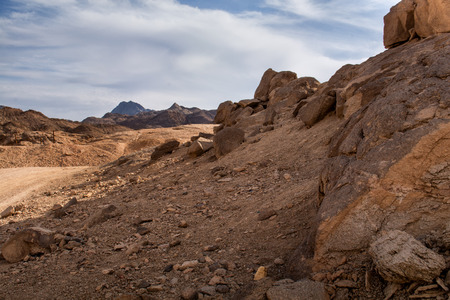 geologists: Landscape in the desert in Egypt. Rocky hills. Blue sky with many white clouds. Stock Photo