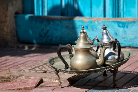 small table: Decoration on the street, small table with traditional arabian tea pots.