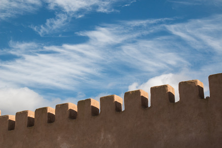 fortification: Detail of the old fortification in the late afternoon light. Cloudy sky in the background. Stock Photo