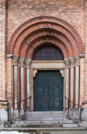 anton: Saint Anton Church with its bricks facade. Entrance to the church.