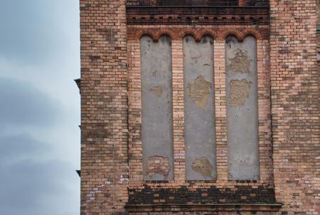 anton: Bricks walls of the Saint Anton Church in Vienna. Cloudy sky.