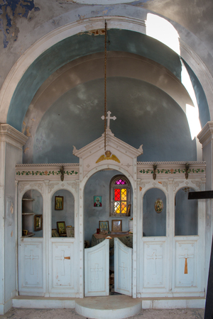 christian religion: Old abandoned orthodox church in Greece, left including all the equipment.